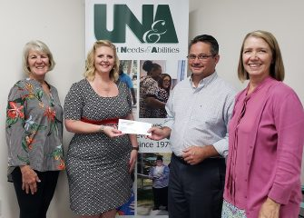 ESBLN/SACC Presents Check to United Needs & Abilities (UNA)
