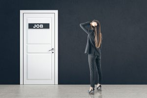 Businesswoman Looking On White Door With Job Sign. Business And