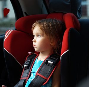 thumbnail_Child-in-auto-baby-seat-in-car-12137609